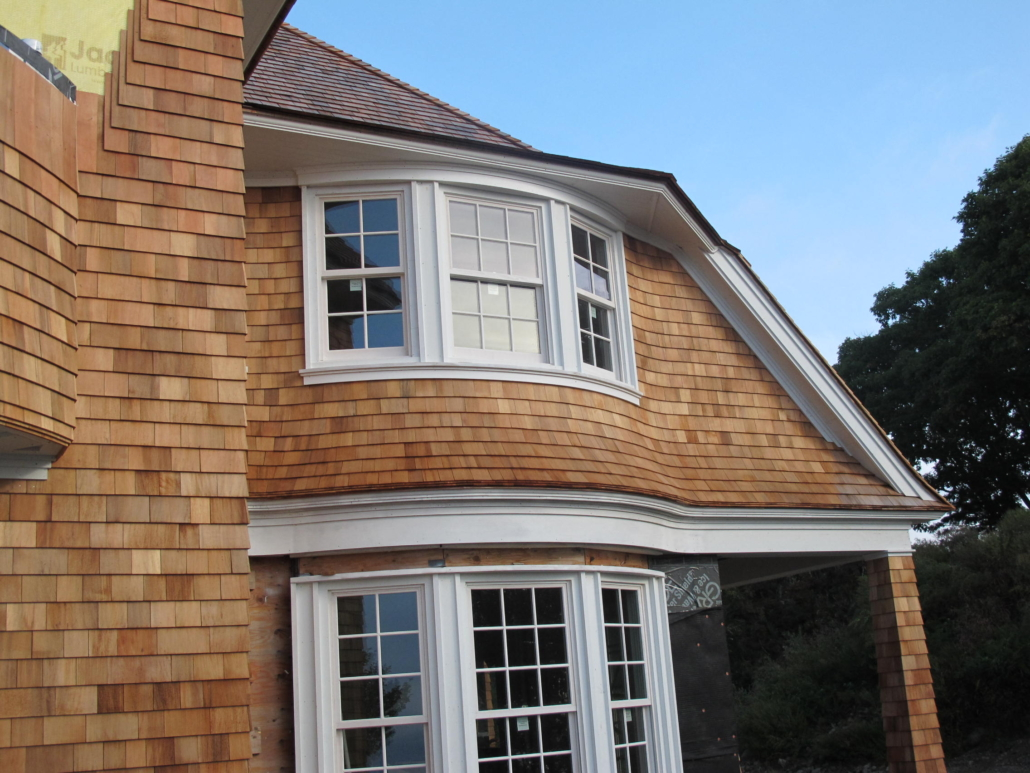 Curved window and siding